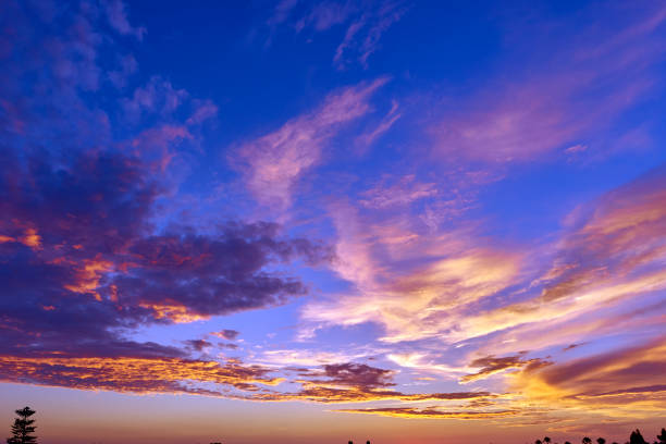 tropical evening sky aglow from the setting sun stock photo
