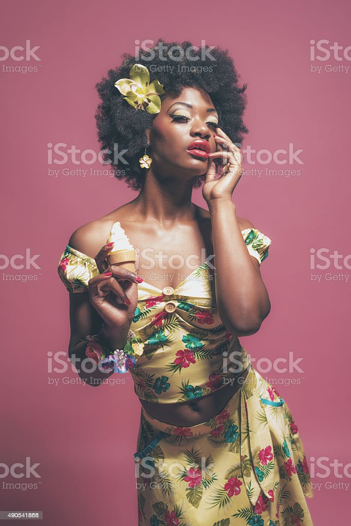 Tropical Fashion Afro American Pin-up Holding Ice cream. stock photo