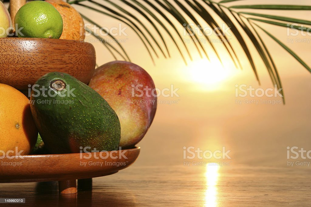 Tropical fruits & sunset royalty-free stock photo