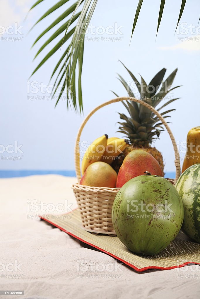 Tropical fruits at the beach royalty-free stock photo