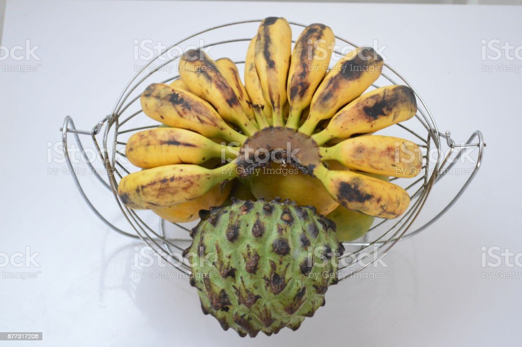Tropical fruits made up of bananas, mangoes and annones stock photo