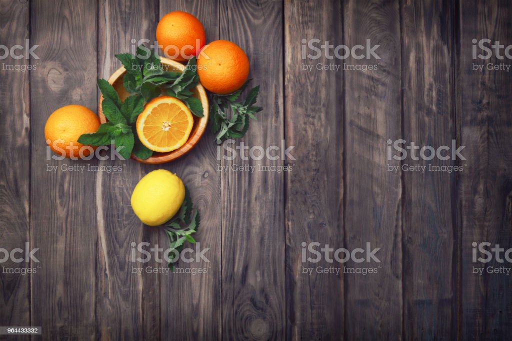 tropical fruits on a wooden background. Flat lay. Food background. Healthy lifestyle. - Royalty-free Citrus Fruit Stock Photo
