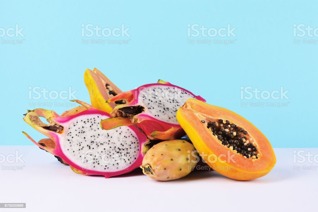 Tropical fruits on white table. stock photo