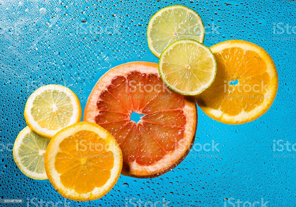 Tropical fruits with water drops stock photo