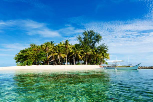Tropical Guyam Island with traditional fishing boats, Siargao stock photo
