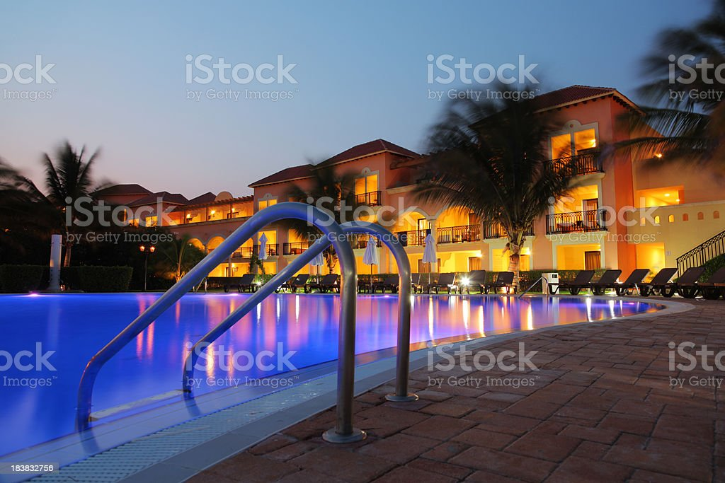 Tropical Hotel Pool at Sunset stock photo