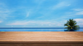 Tropical Infinity Pool And Empty Wooden Table