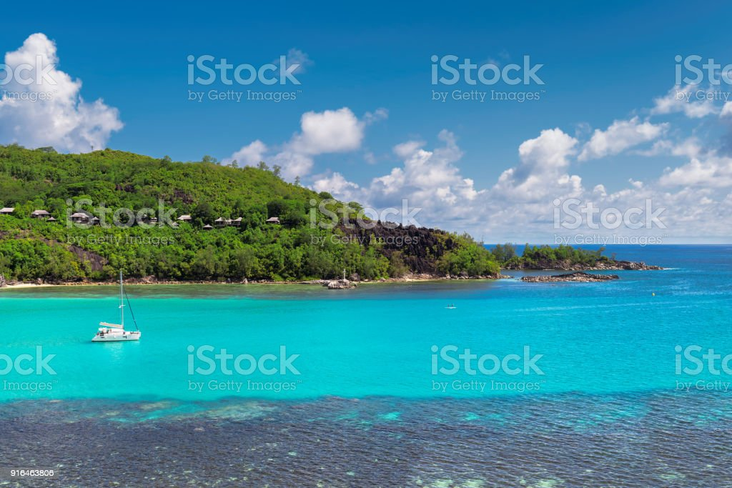 Tropical island and sailing boats in Seychelles. stock photo