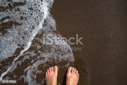 istock Tropical island background with woman legs 824576634