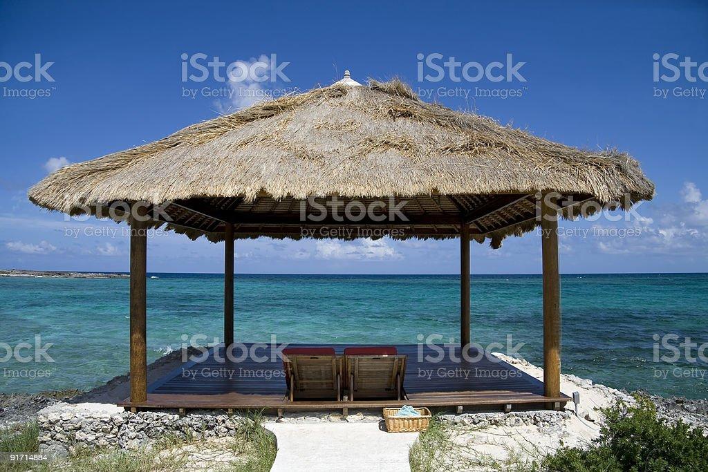 Tropical island beach hut royalty-free stock photo