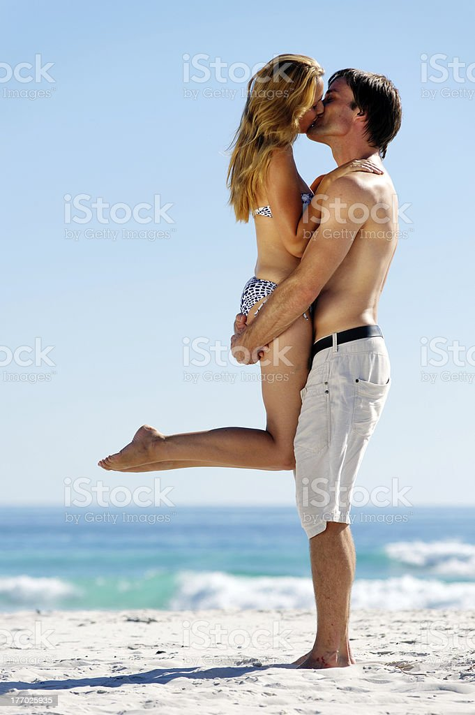 tropical island couple kiss royalty-free stock photo