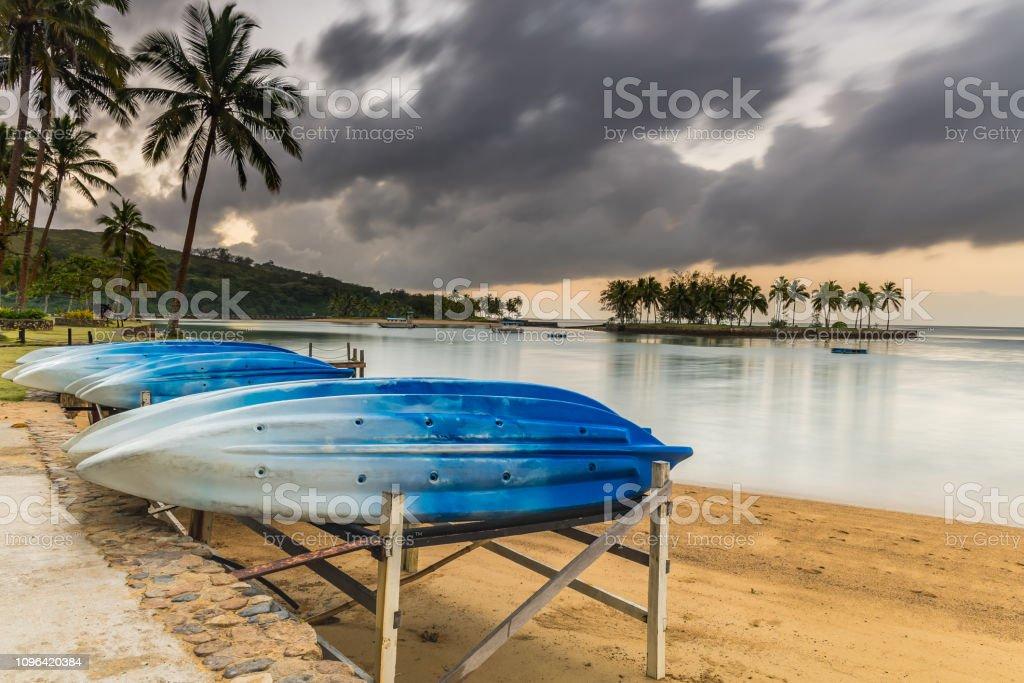 Tropical Island Holiday Sunrise Seascape with Kayaks stock photo