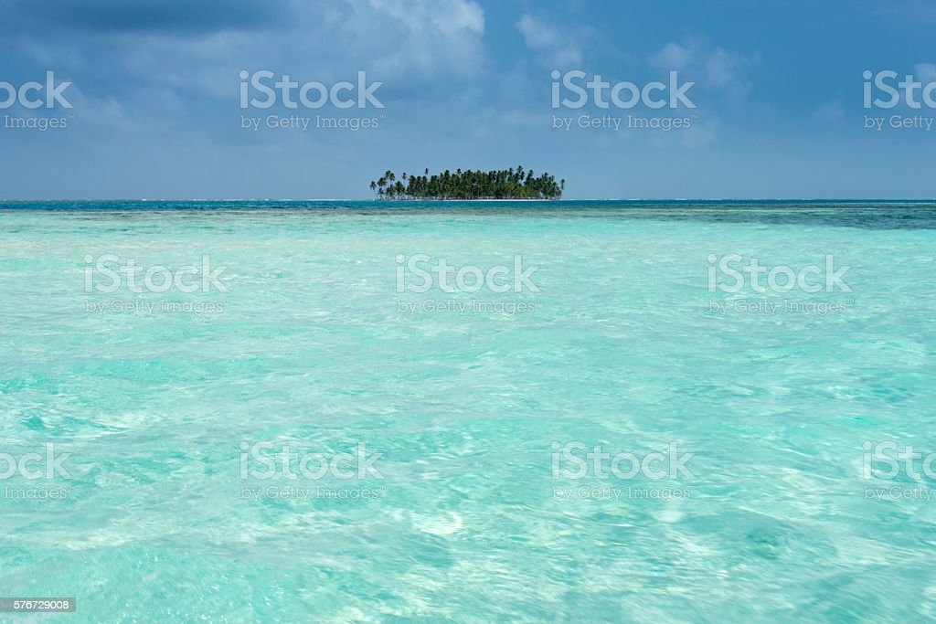Tropical island  in a turquoise sea stock photo
