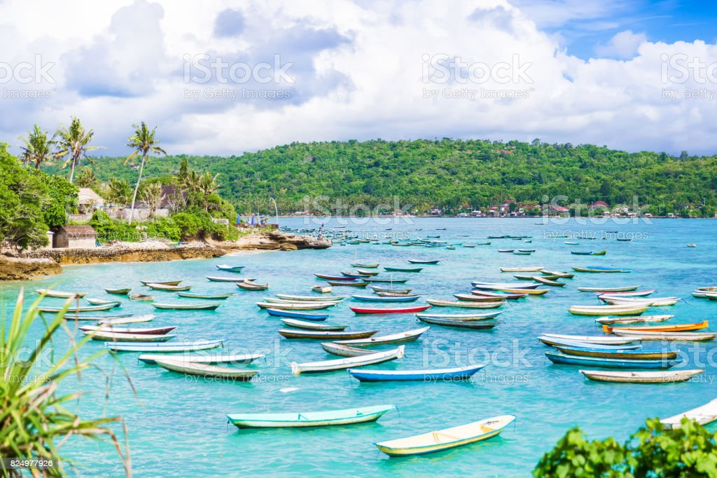 Tropical island in Indonesia, blue ocean with clouds and boats. royalty-free stock photo