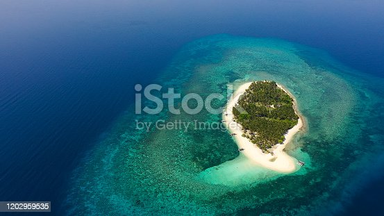 Tropical island on a coral reef, top view. Beautiful white sandy beach for tourists.Digyo Island, Philippines. Summer vacation and tropical beach concept.