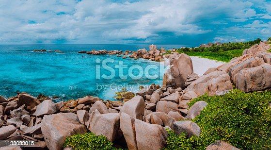 Tropical island landscape, the path for a secret beautiful beach, Anse Marron, La Digue, Seychelles