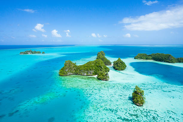 tropical island paradise from above, palau, micronesia - pacific islands stock pictures, royalty-free photos & images