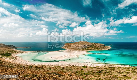 The tropical island of Balos surrounded by transparent turquoise ocean. Located at the Crete island in Greece, seen a hot day in the summer.