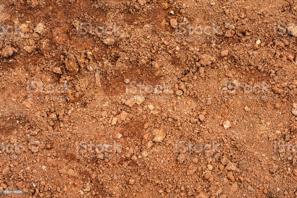 Tropical laterite soil or red earth background. Red mars seamless sand background. Top view stock photo