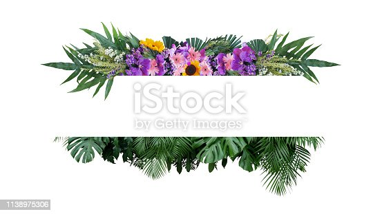 istock Tropical leaves foliage plant bush with colorful flowers floral arrangement nature frame banner on white background. 1138975306