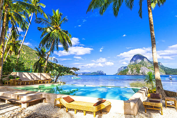 tropical luxury holidays in el nido. philippines - philippines stock photos and pictures