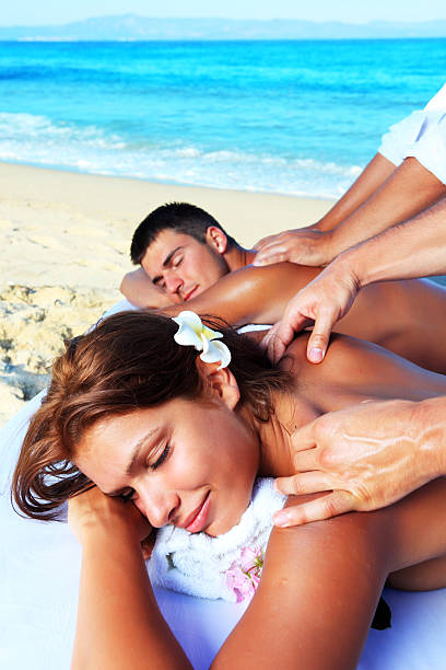 Tropical massage on the beach. stock photo