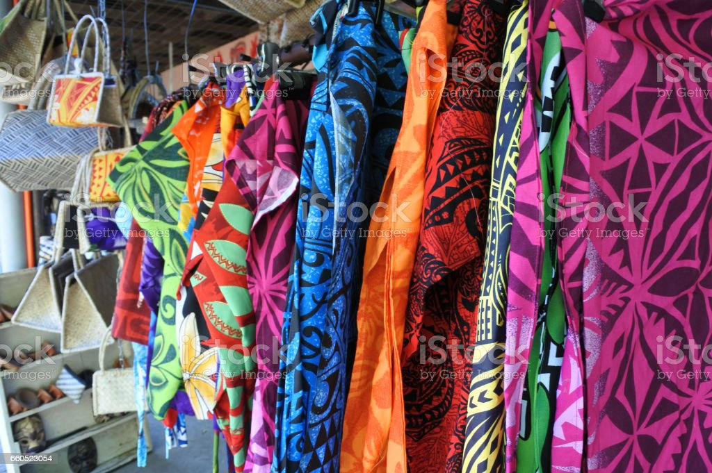 Tropical men shirts on display in the market stock photo