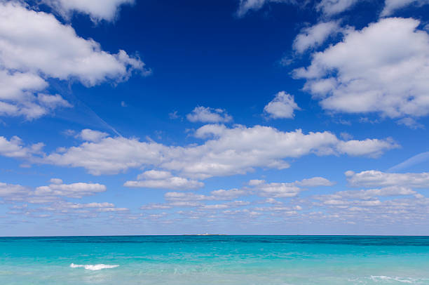 Tropical Ocean and Blue Sky with Fluffy White Clouds stock photo
