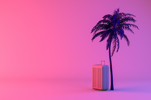 istock Tropical palm tree and suitcase on neon color background, minimal summer and travel concept 1130336291