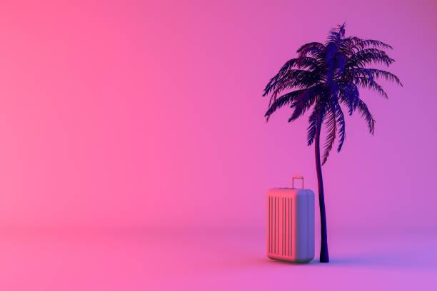 tropische palme und koffer auf neon farbe hintergrund, minimale sommer und reisekonzept - neontasche stock-fotos und bilder
