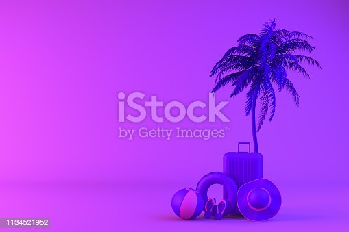 istock Tropical palm tree and suitcase on neon color background, minimal summer and travel concept 1134521952