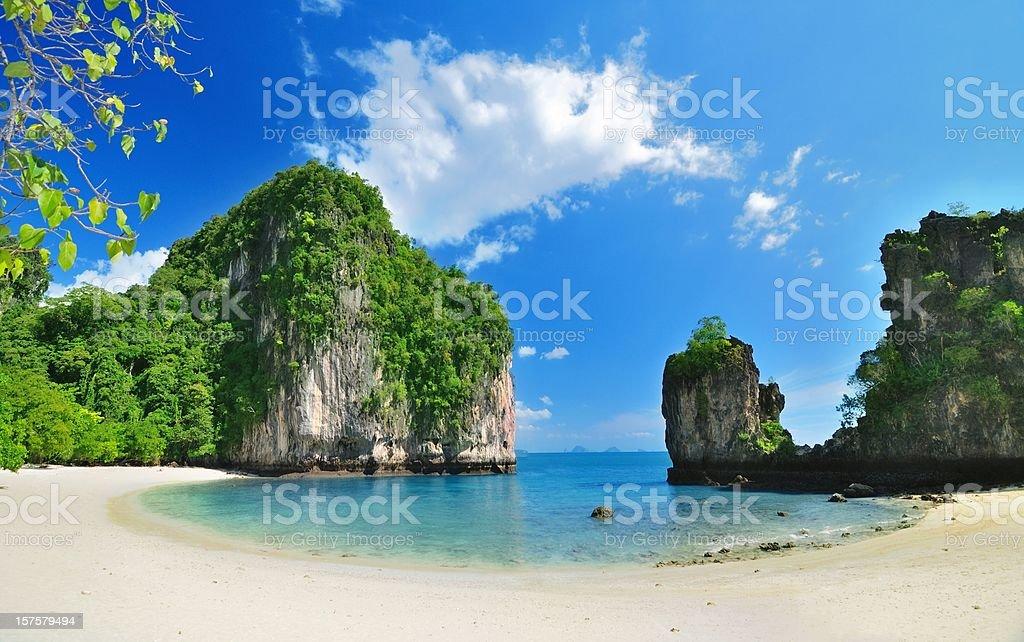 Tropical paradise lagoon beach with mountain stock photo