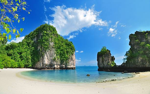 tropical paradise lagoon beach with mountain - phuket stock photos and pictures