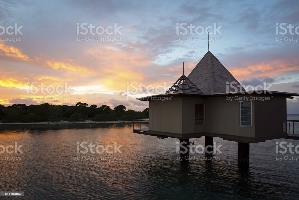 Tropical Paradise Luxury Over Water Resort at Sunrise royalty-free stock photo