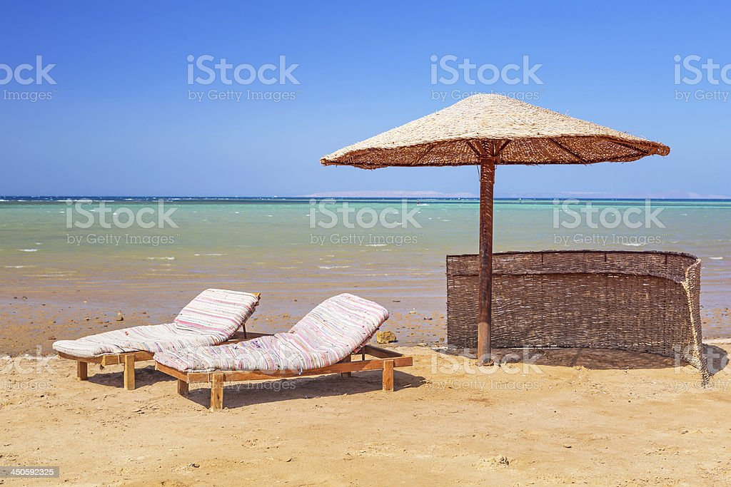 Tropical parasol on the beach of Red Sea royalty-free stock photo