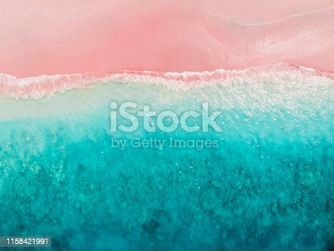 Tropical pink beach with blue sea. Komodo islands - aerial view