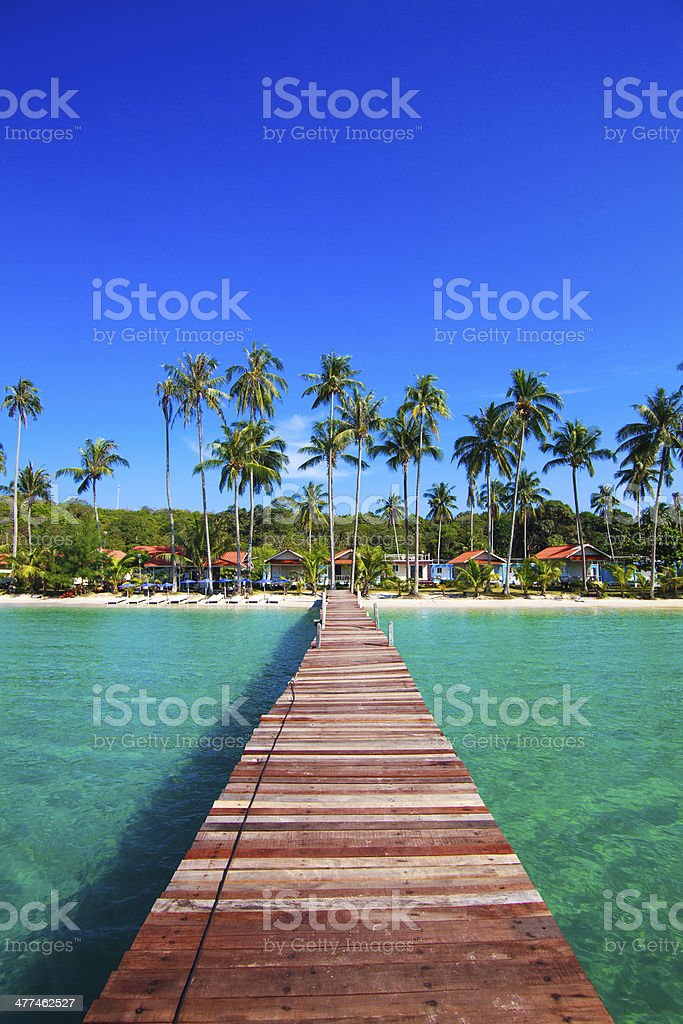 Tropical Resort.  boardwalk on beach stock photo