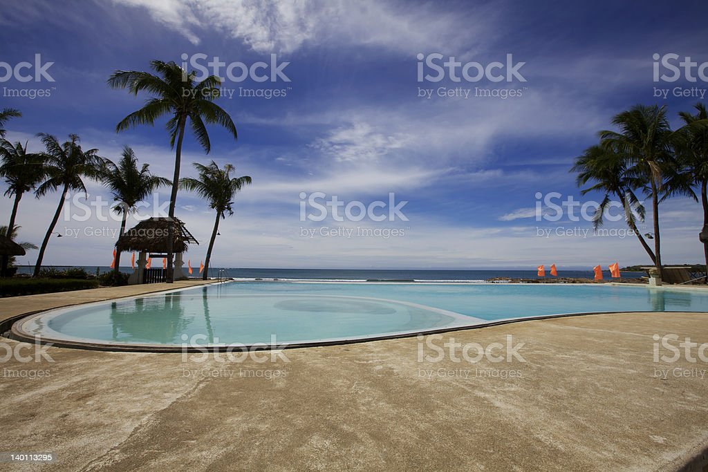 Tropical Resort Pool on Ocean royalty-free stock photo