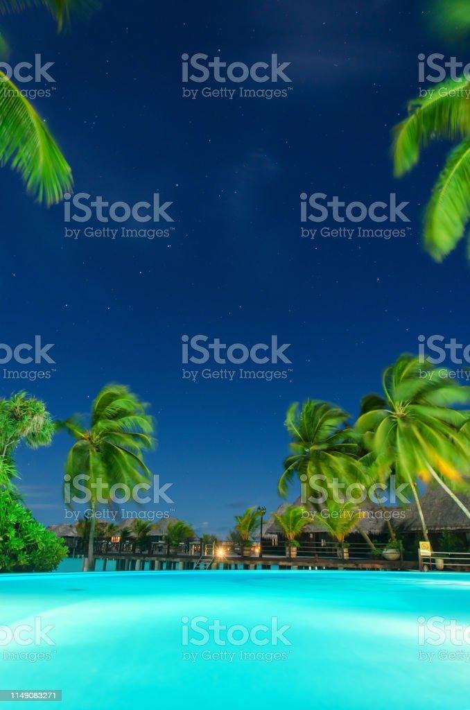 Tropical Resort Swimming Pool At Night Maldives Stock Photo
