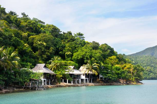 Tropical resort with bulgalows at the coastline of the Koh Chang island, Thailand. Tropical resort with bulgalows at the coastline of the Koh Chang island in Trat province of Thailand. koh chang stock pictures, royalty-free photos & images