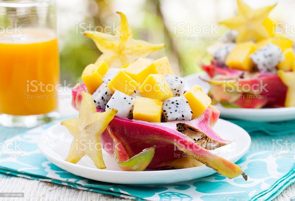 Tropical salad: pitahaya, mango, dragon fruit bowl stock photo