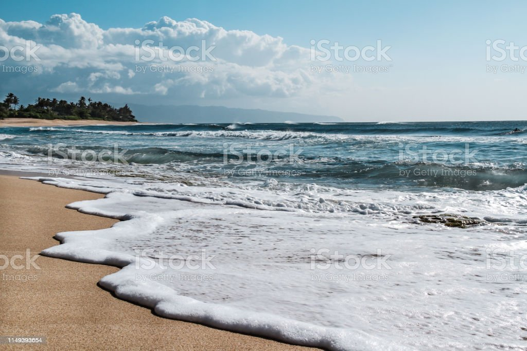 Tropical sandy beach in Hawaii, summer vacation travel holiday background stock photo