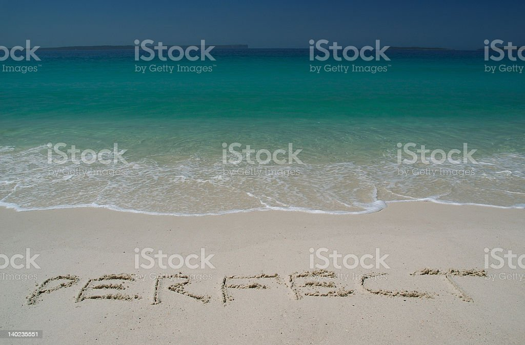 Tropical Sandy Beach With 'Perfect' Inscription on Sand royalty-free stock photo
