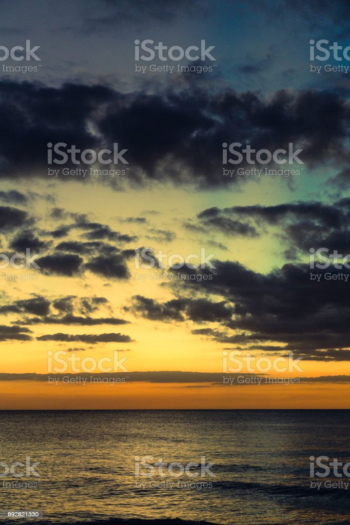 Tropical sea and clouds at dusk stock photo