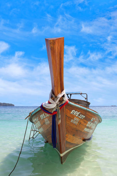 Tropical sea with long tail wooden boat in South Thailand stock photo