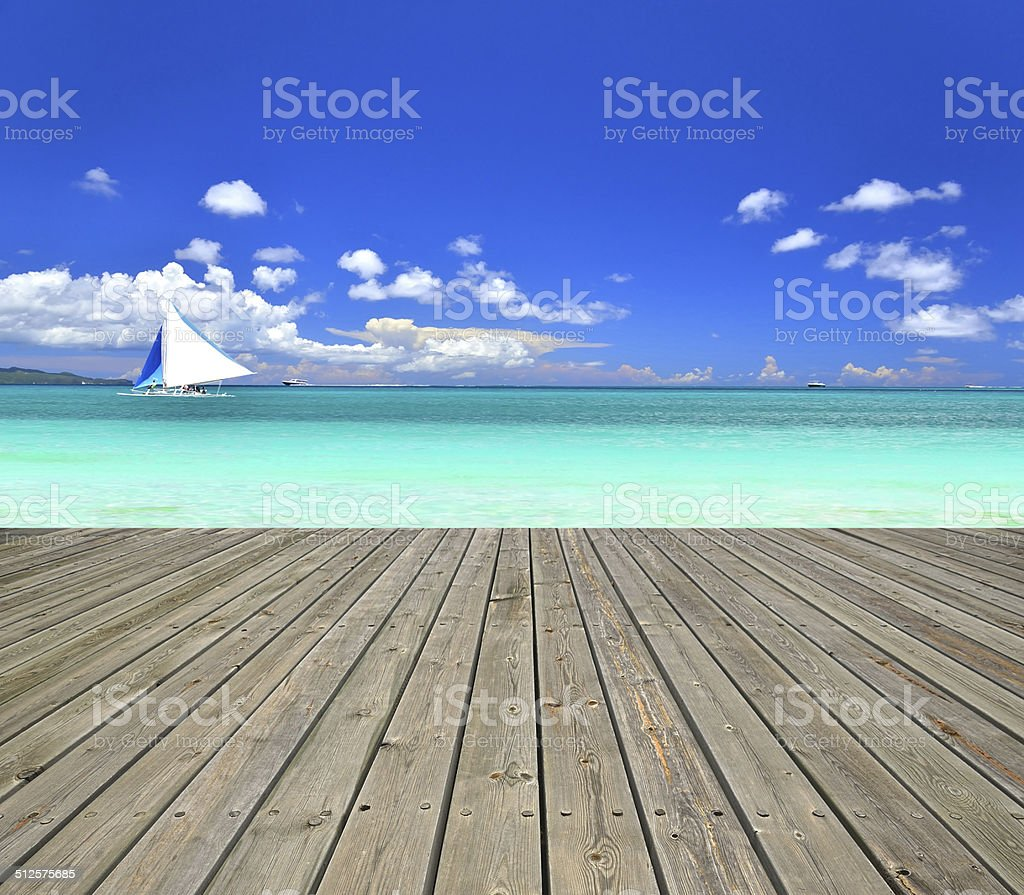 Tropical seascape with wooden platform stock photo