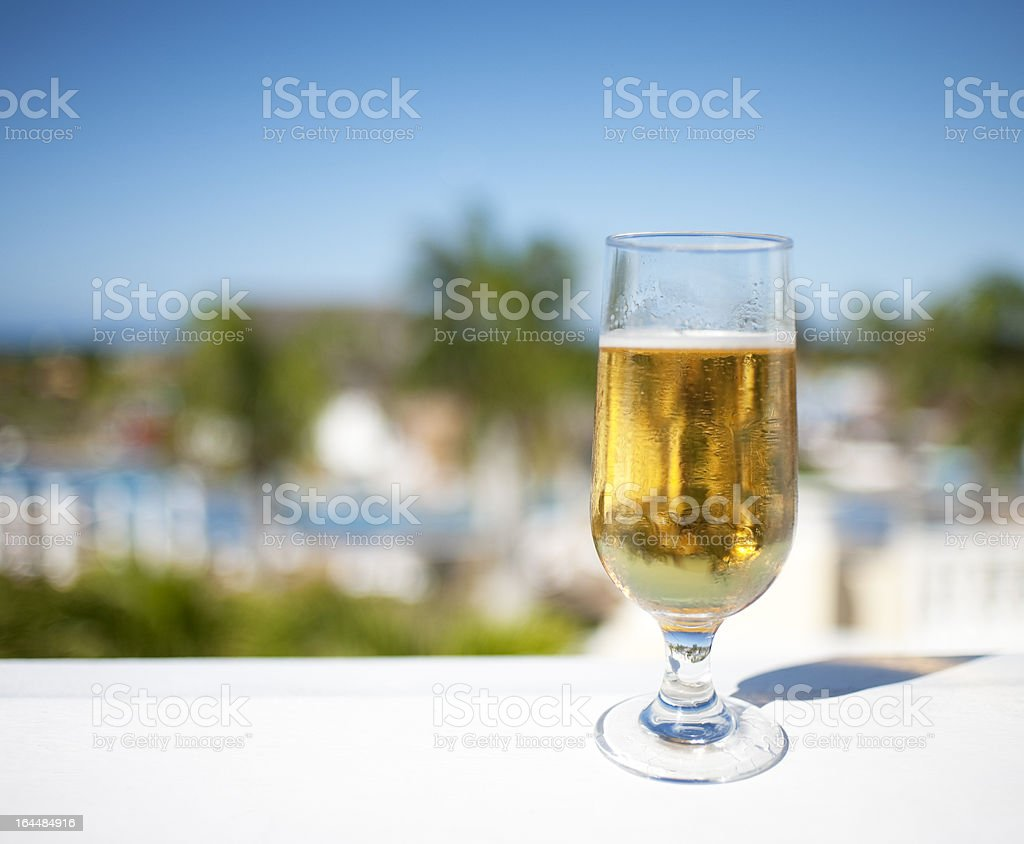 Tropical Setting, Beer, Resort Background royalty-free stock photo