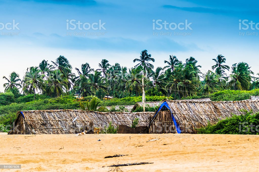 Tropical Sky with Goa Huts stock photo