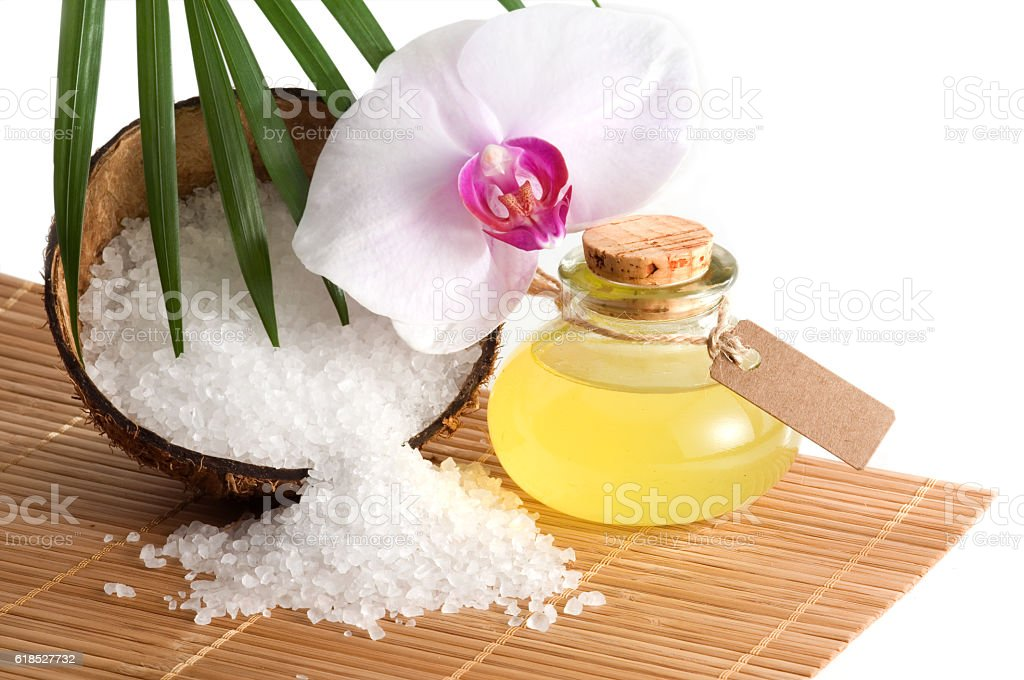 Tropical spa still life with orchid blossom and essential oil stock photo