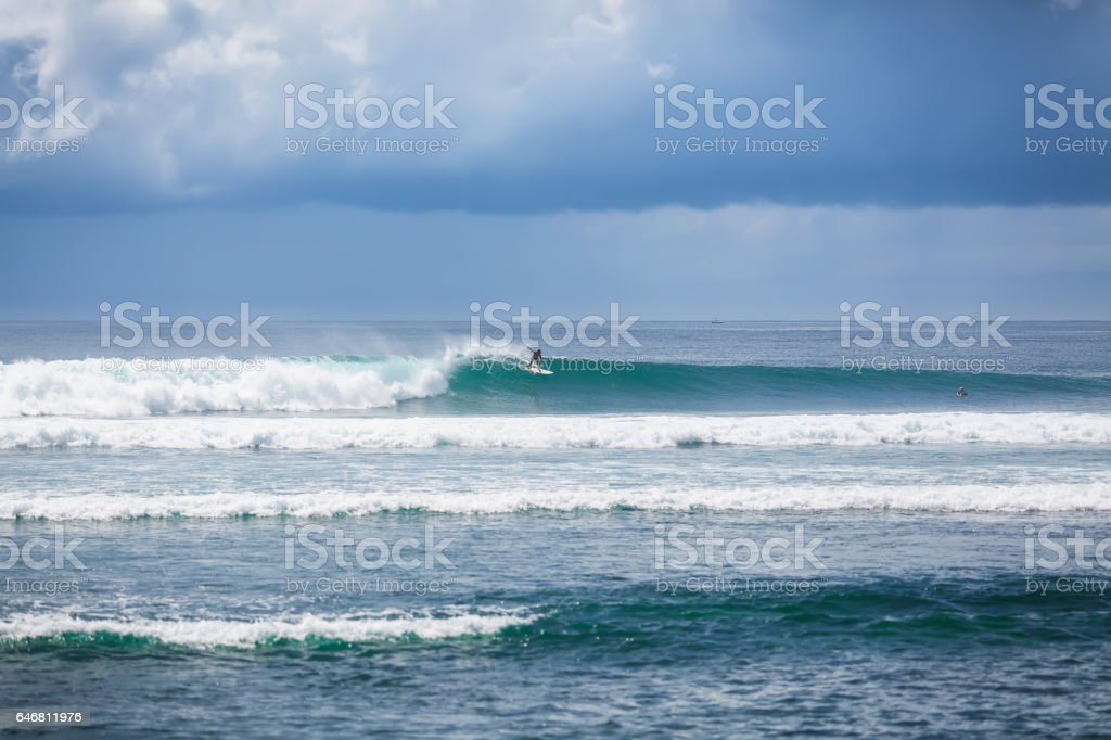 Blue waves in Bali. Tropical surfing. Relax. Sunny day in paradise